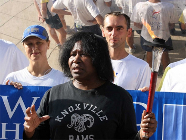 Joan Holds a Torch For Harmony Run 2010